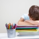 young boy stressed from school work